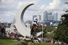 Boyd Martin, of the United States, and his horse Otis Barbotiere competes in the equestrian eventing cross-country stage at the 2012 Summer Olympics, Monday, July 30, 2012, in London. (AP Photo/Jae C. Hong)
