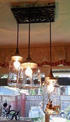 Hang mason jars in varied sizes as an awesome rustic chandelier.