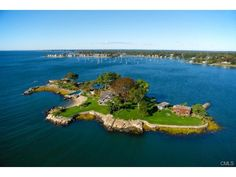 sothebys - Private Island with year-round access via mainland property: (75 Bluff Ave, Rowayton, CT). Mainland property features garage/ / cottage with ample paved parking and deepwater dock. Island includes: Main Residence, Caretaker's Cottage with bedroom, 2 baths, fireplace, kitchen and study. Boat House offers workshop, game room, and bedroom and bath. Separate Tea House. In-ground pool. Private beaches. Protected harbor with stone sea wall, concrete / stone pier and floating dock.