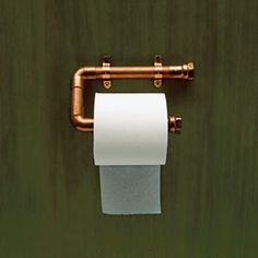 Toilet paper holders made from copper fitting. Perfect for steampunk bathroom. (This would be great with matching towel bars, too!)