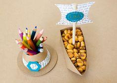 Pilgrim-themed kids' table with kraft paper at Thanksgiving dinner