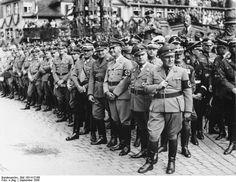 Martin Bormann, Robert Ley, Wilhelm Frick, Hans Frank, Franz von Epp, Joseph Goebbels, and Walter Buch at a Nazi rally, Nürnberg, Germany, 12 Sep 1938.
