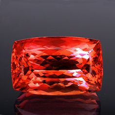"""This 14.37-carat gem """"Imperial Topaz"""" is the perfect example of what an imperial should look like.     This stone has a combination of fiery red, mixed with a brilliant orange and just the right splash of peach to bring it to the top of the list of the most desired topaz colors, second only to a true red, which has proven to be the rarest color to find in gemmy material."""