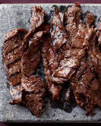 Recipe for Korean Sizzling Beef - This succulent recipe is based on bulgogi, a classic Korean dish of sliced beef that's marinated in soy sauce, sugar, sesame oil and garlic, then grilled..
