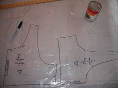 Pattern saving/transfer tutorial - SEWING IN GENERAL. When using a commercial pattern, and you know you always have to alter the pattern due to your bustiness, etc., transfer pattern to kitchen garbage bag for something more enduring than the paper patterns.