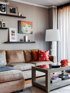 Fabulous table!!!  Photo wall with some tweaks would be nice.  Eclectic Living-rooms from Lugbill Designs on HGTV