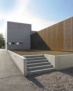 The raw concrete exterior of this winery building in Germany is in such contrast to its neighbours that local residents think the structure is still under construction.