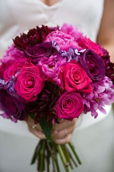 Purple/pink peonies and red dahlia. Love this! Call the florist I need a redo appointment!