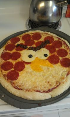 Angry Birds Pizza! Order Papa Murphy's rearrange peperronis, have yellow colby rounds cut and ready, can of olives, and bake!  basketballs and butterflies: Angry Birds Party