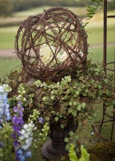 This interesting branch ball by Signature Flowers would make for lovely garden-esque decor. Photo by Artworks Tulsa Photography. #wedding #centerpiece