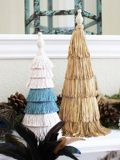 Luxe-Rustic Mantel Decorating Ideas: Taking center stage are a trio of topiary trees, created using Styrofoam cone bases, assorted fringe trim, and wooden finials. From DIYnetwork.com