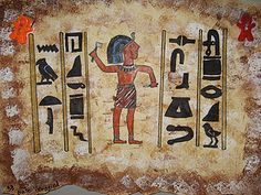 Egyptian Friezes using Egyptian rules for depicting the human figure and hieroglyphics.