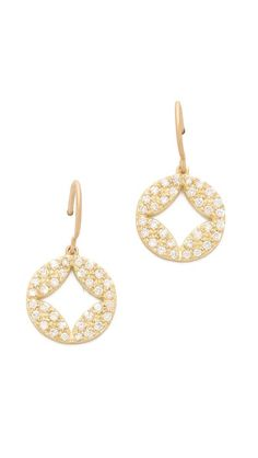 I love the delicate scale of this signature diamond earring. fashion, wolf open, jami wolf, aladdin disc, diamond earrings, pave aladdin, disc earring, gold earrings