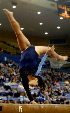 college gymnast with one hand on the balance beam, collegiate gymnastics, grace, form, UCLA  Bruins #KyFun colleg gymnast, artist gymnast, balanc beam