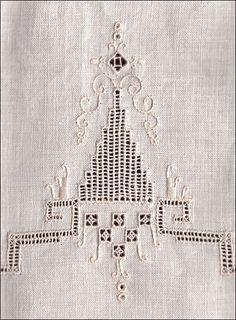 Whitework linen towel with drawn threadwork accented with embroidery in stem and satin stitch. Whitework embroidery refers to any embroidery technique in which the stitching is the same color as the foundation fabric (traditionally white linen).