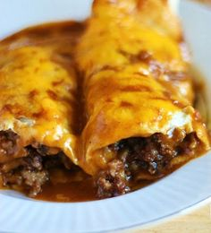 ENCHILRRITOS - part enchilada, part burrito - 1/4c butter, 1/4c flour, 4c water, 3Tbsp chili powder, 1 tsp garlic salt, 1 lb ground beef, 1/4c chopped onion, 1c refried beans, 8 warmed flour tortillas (8in), 3c shredded cheese, Optional toppings: shredded lettuce, chopped tomatoes, sour cream