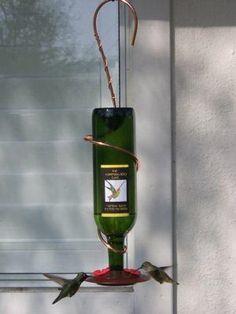 Upcycled wine bottle hummingbird feeder