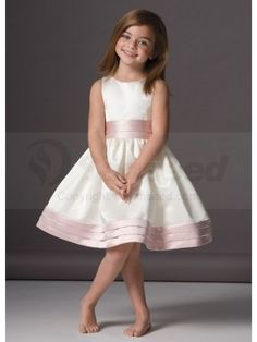 Flower girl dress, but with sash at middle and bottom in the same color as bridesmaid dresses.