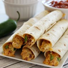 Jalapeno Popper Chicken Taquitos make a perfect appetizer or meal idea! Easy to make!