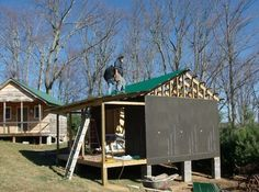 Working on roof of tiny cabin   How to Build a Mortgage free Small House for $5,900