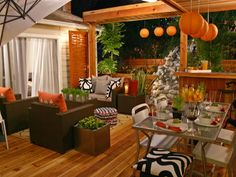 Fall doesn't have to have the traditional, muted feel we are used to. A funky, young fall touch is added to this outdoor space by mixing strong pops of orange with contemporary furnishings. The bright lanterns are a playful way to add lighting, while the bright orange pillows are an easy way to incorporate a new color with each season. A fun screen completes the look, making this autumn patio feel like a destination.