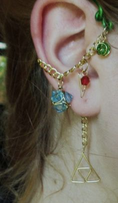 The Legend of Zelda's Wise Ear Bend with Hanging Spiritual Stones and Triforce. $19.95, via Etsy.