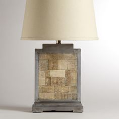 Jigsaw Wooden and Metal Table Lamp Base - With the elegant look of reclaimed wood and a modern jigsaw design, our Jigsaw Wooden and Metal Table Lamp Base makes a striking statement. Crafted from mango wood with metal accents, it easily complements any tabletop or room. Customize with any of our table lamp shades for the look of your choice.