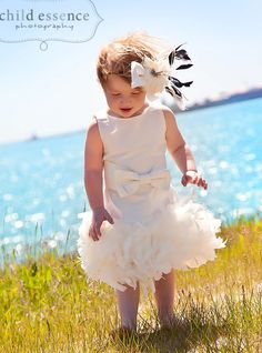 Ivory  Luxury  Dress for flower girl, tea party, special occasion, made of silk dupioni fabric, with 2 rows soft  and fluffy feathers.. $145.00, via Etsy.