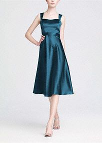 Vintage-inspired, this satinstyle combines modern sophistication with old hollywood glamour.  Wide strap tank bodice is supportive while sweetheartneckline is ultrafeminine.  Tea-length skirt mixes flirty with flattering to create a timeless silhouette.  Lined Bodice. Back zip. Imported polyester. Dry clean only.  Get inspired by our colors.