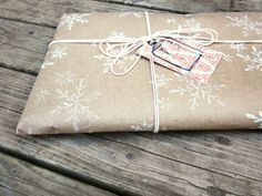 How I plan to wrap presents this holiday season: Use all the brown grocery bags I've saved up, stamp it with some snowflakes and wrap with string. Make handwritten cards to tie to the string. Voila. hand stamped, gift wrap, wrap idea, season, brown paper packages, wrap paper, paper snowflakes, holiday gifts, paper patterns