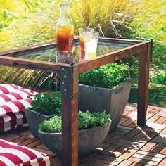Transform an old window into a patio table. Here, one sash of a double-hung rests on scrap-wood legs about 2 inches square, attached with salvaged door hinges and new brass screws. The wood pieces are unified with a dark stain. This single pane is safety glass, but you can replace a regular window pane with acrylic sheeting cut to fit and secured with a bead of clear silicone caulk. Then just add a clear coat to protect wood...