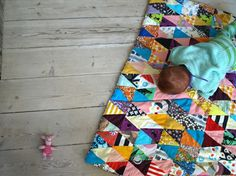 Scrappy triangles quilt.
