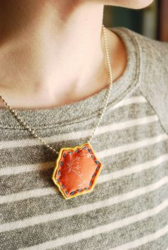 @Mollie Johanson has made an accessory that just about any quilter would want! You won't even need to do any paper piecing to make this adorable hexagon quilt necklace. Just grab your favorite fabric and you'll be done in no time!