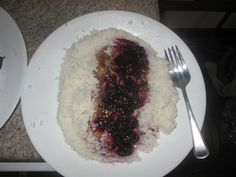 Rice, pork, with a blueberry glaze.