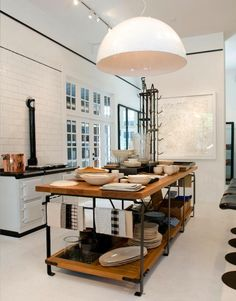 Classic white and black kitchen, industrial center island (w/ casters), modern light fixture