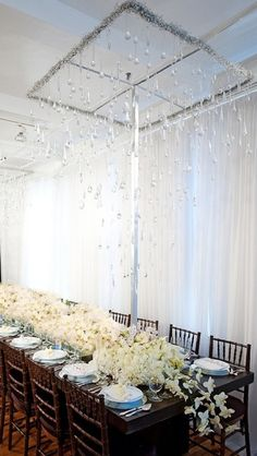 Elegant Wedding inspiration - enormous overflowing flowers off the table...