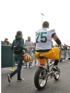 Packers players have been riding children's bicycles to training camp practice since the Vince Lombardi era. #bryanbulaga #75 #packers #nfl #trainingcamp #bicycles #tradition #vintage