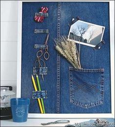 Bulletin board. Love the photo corners and pocket repurposed jean element on board.
