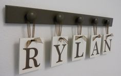 First time I've ever seen Rylan!! Will have to do this for my nephew, Rylan!!! Baby name hanging idea! =) can be used as a coat hanger when they grow up :)