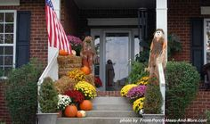 Hay bales, colorful mums, scarecrows and an American flag.... perfect way to greet holiday guests or trick-or-treaters.