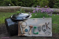 Create a cool sign with reclaimed wood & repurposed objects.
