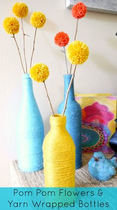 Pom Pom Flowers & Yarn Wrapped Bottles...a fun way to decorate with scrap yarn and old bottles!  #diy #home #yarn