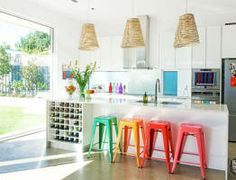 Love the white + coloured stools + concrete floor!