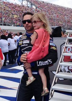 Jimmie and Evie walk across the stage before the start at Michigan.  Happy Father's Day!