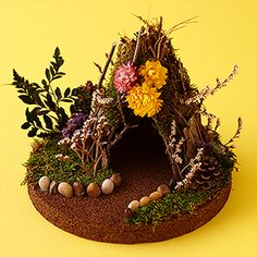 This DIY fairy house is great for any little child's imagination!