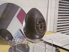 The mystery stone from Lake Winnipesaukee is an alleged out-of-place artifact (OOPArt), reportedly found in 1872 while workers were digging a hole for a fence post. It is a carved stone about 4 inches (100 mm) long and 2.5 inches (64 mm) thick, dark and egg-shaped, bearing a variety of symbols.