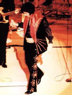 Elvis Presley In Concert wearing the  Black Cisco Kid Two-piece with red shoulders