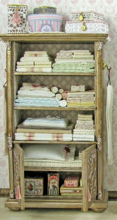 Love this charming linen cabinet.
