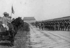 "U.S. Cavalry and Infantry marching toward Pekin (Beijing) during the China Relief Expedition ""Boxer Rebellion"", 1898-1900.  The cavalry wear the new brown uniforms, while the infantry are in the older blue uniform.U.S."