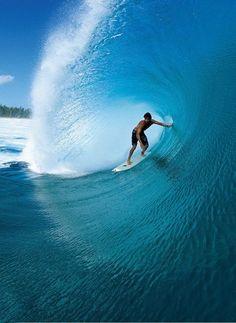 Catch a wave in Bali, Indonesia.
